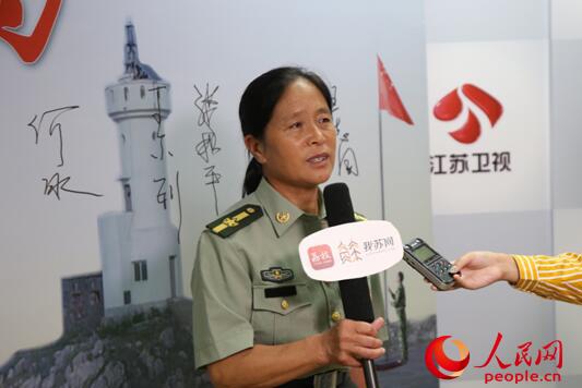 王继才同志的妻子王仕花在发布会后接受记者采访